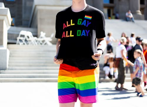 Person in a Black and Rainbow Colored Shirt and Shirts