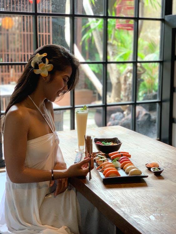 Woman Holding Chopstick