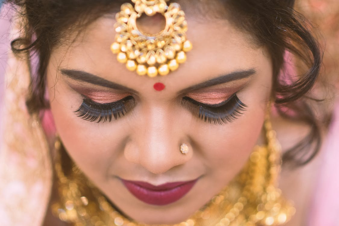 Close Up Photography of Woman wearing Eye Makeup and Jewelries