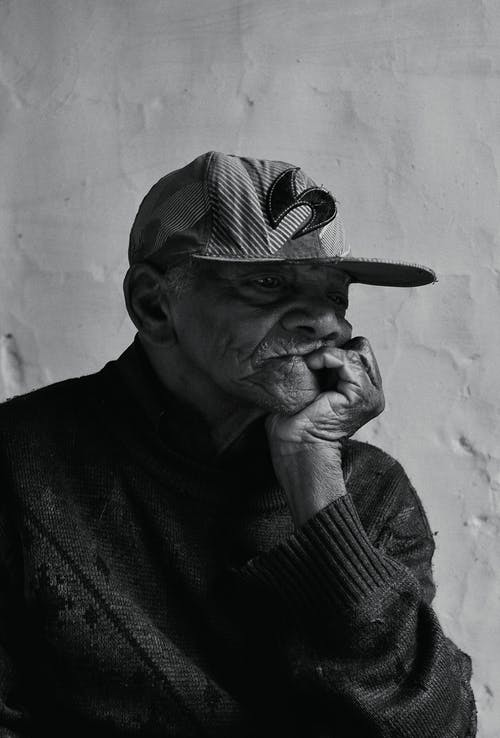 Portrait Photo of Elderly Man Leaning Chin on his Hand Palm