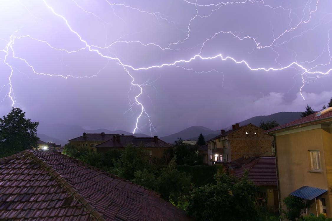Brown Concrete House Under Lightning