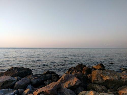 Gratis arkivbilde med blå himmel, himmel, sjø, sol
