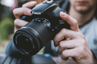 man, camera, lens