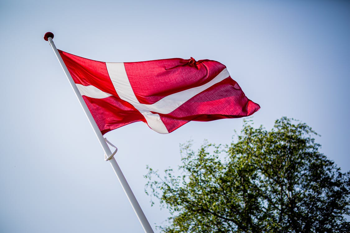 Low angle Shot Photography of Danish  Flag