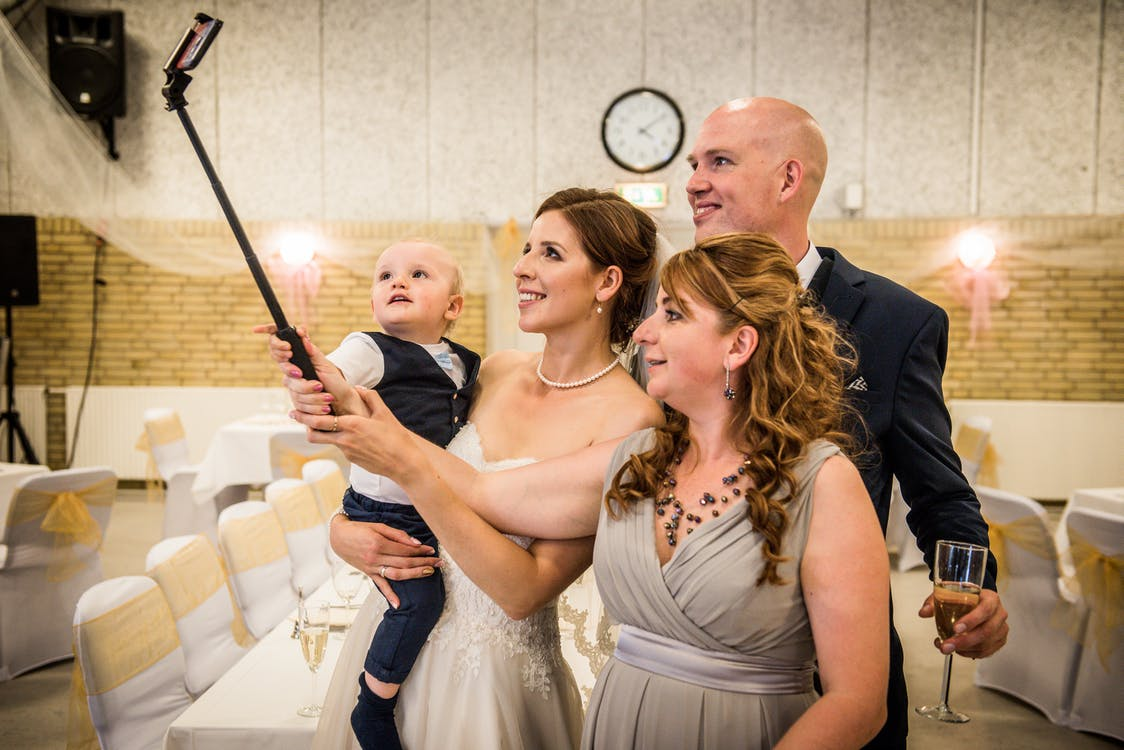 Four People Taking a Selfie