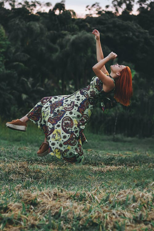 Time Lapse Jumpshot Photography of Woman Jumping on Grass