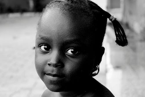 Greyscale Close-up Photo of Young Girl