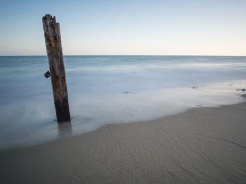 Free stock photo of beach, ocean, post, sand