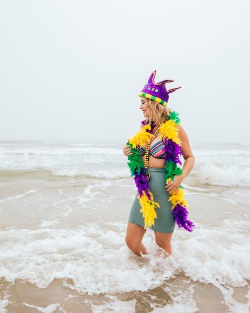 Woman Wearing Garland in Shore