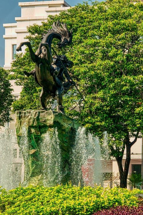 Man Riding Horse Statue
