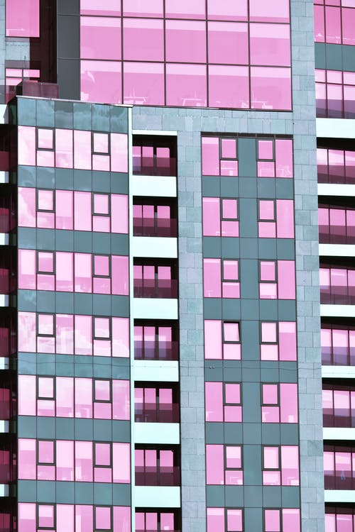 Gray and Pink Glass Buildings