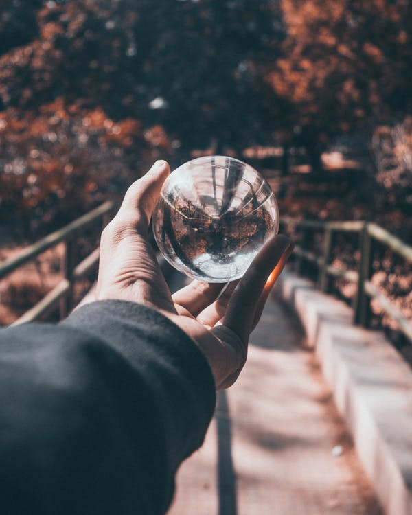 Photo of Person Holding Lensball