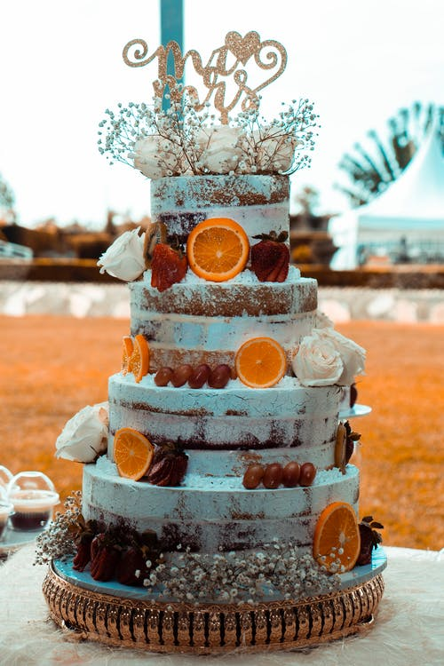 4-tier Cake With Sliced Oranges on Surface