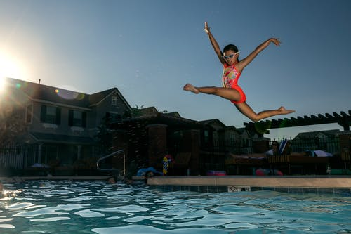 Girl Jumping On Swimming Pool