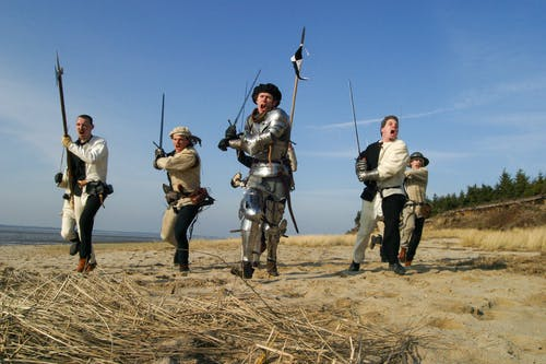 Photo of Men Holding Weapons