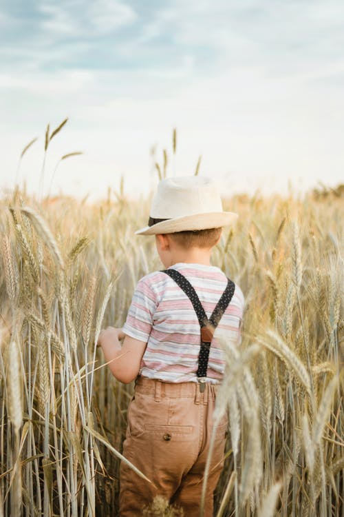 Photo of a Boy Wearing Suspenders