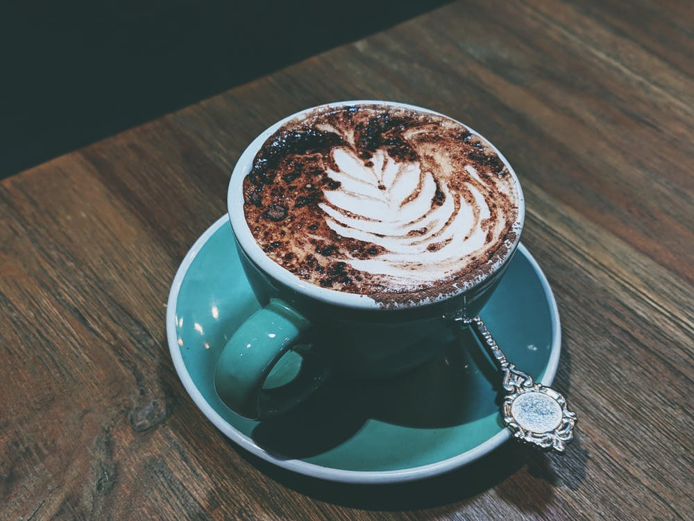 Photo Of Coffee On Wooden Table