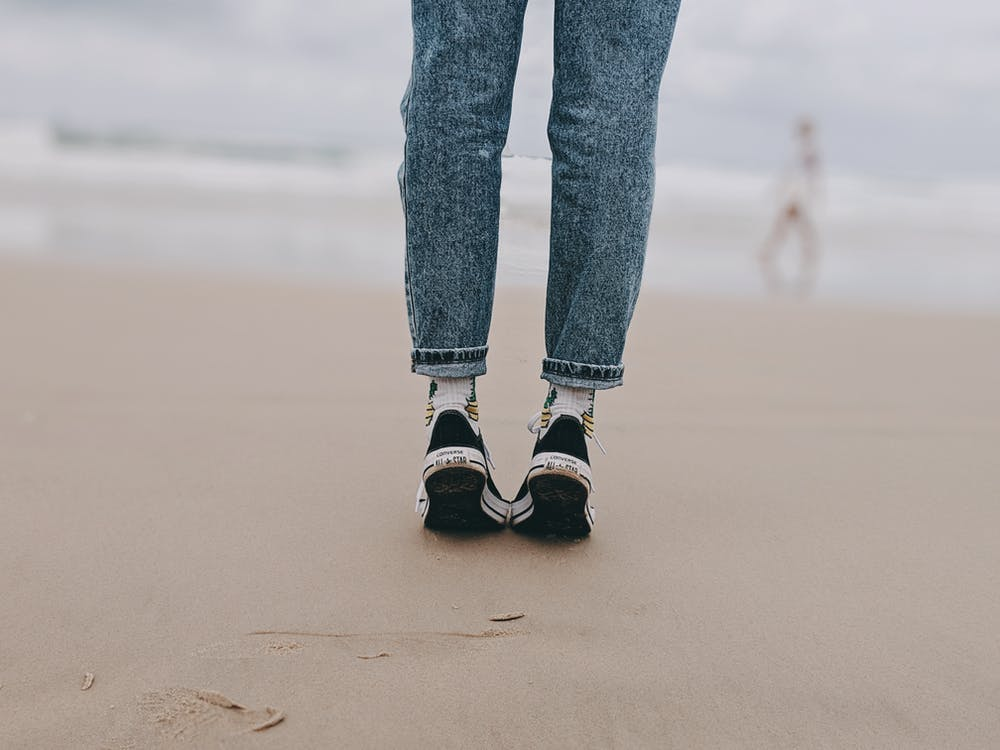 Photo of Person Wearing Denim Jeans