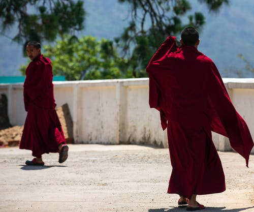 Two Monk Wearing Red Monk Dress