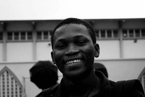 Grayscale Portrait Photo of Smiling Man