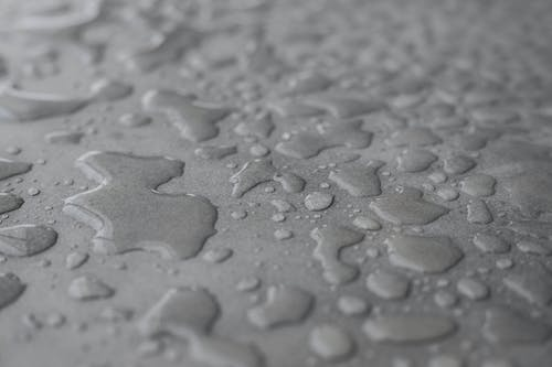 Close-Up Photo of Waters on Grey Surface