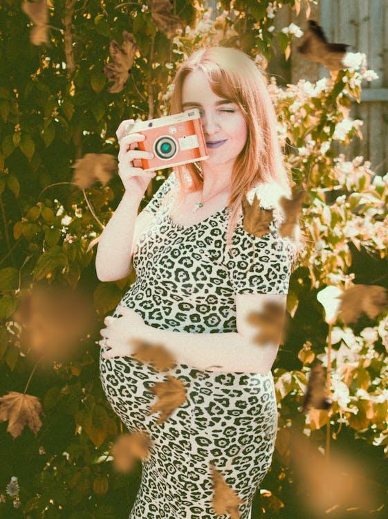 Pregnant Woman Wearing White and Black Leopard Print Dress