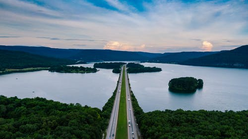 Aerial Photography of Road Surrounded by Body of Water