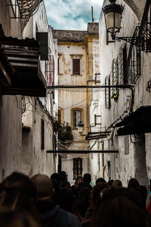 People Walking on Building Alley