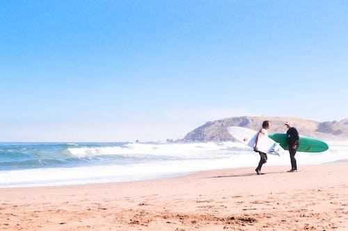 Photos gratuites de bord de mer, debout, eau, été