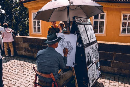 Person Drawing On The Streets
