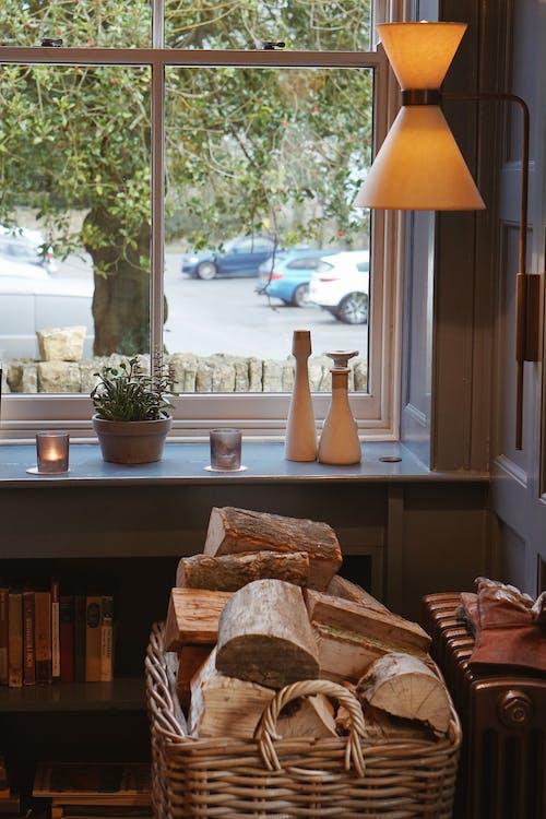 Two White Ceramic Vases Near Window
