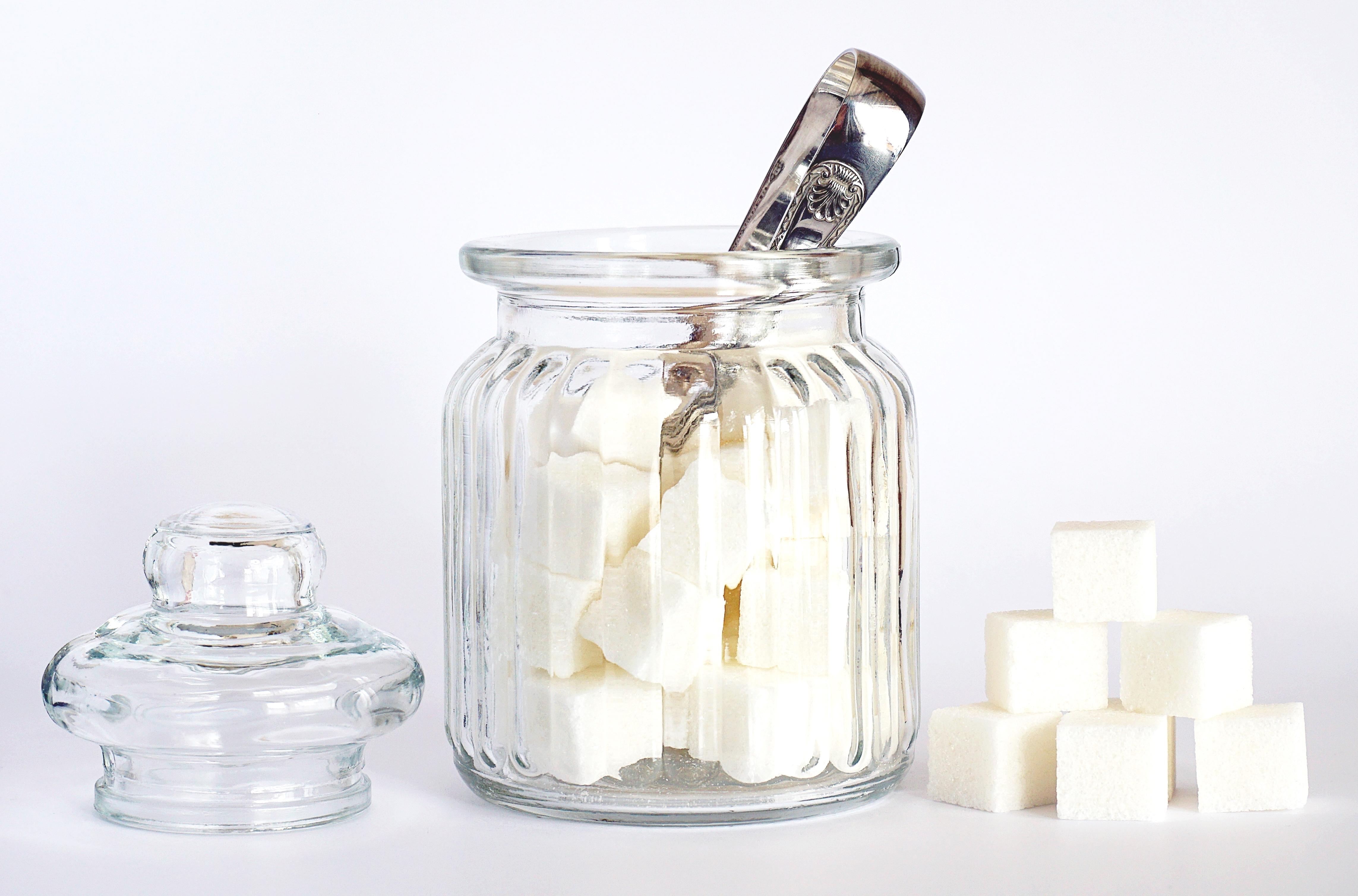 Close-Up Photo of Sugar Cubes in Glass Jar