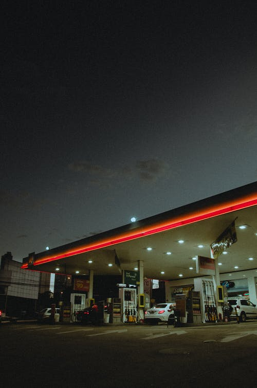 White Car on Gas Station during Night