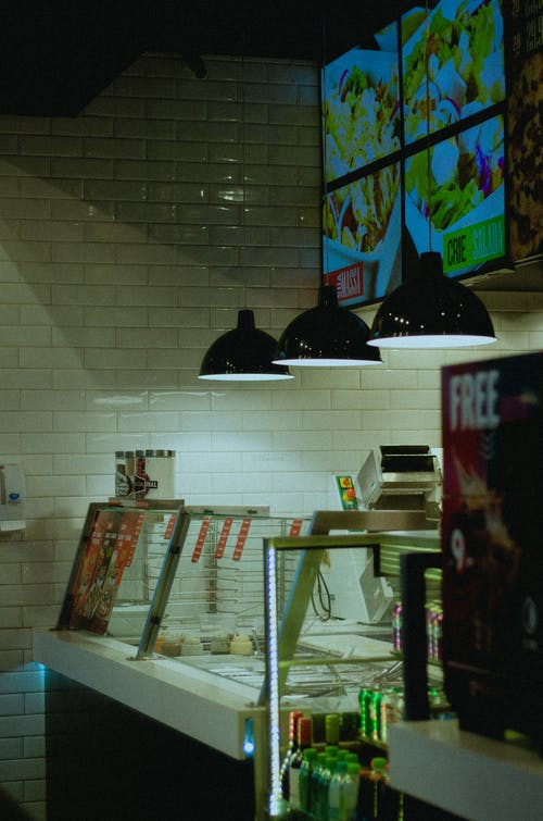 Turned-on Pendant Lamps over Food Display Case