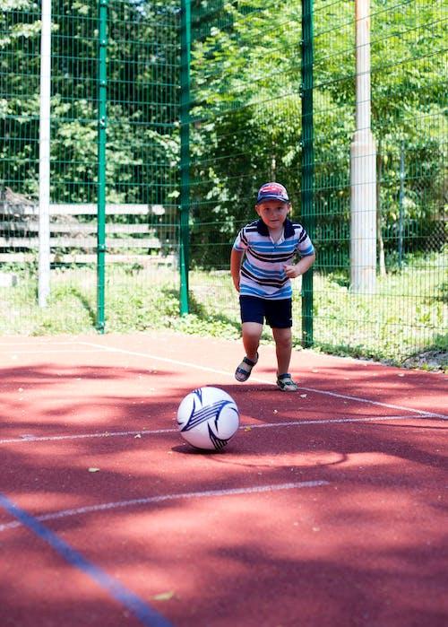 Immagine gratuita di bambino, calcio, estate
