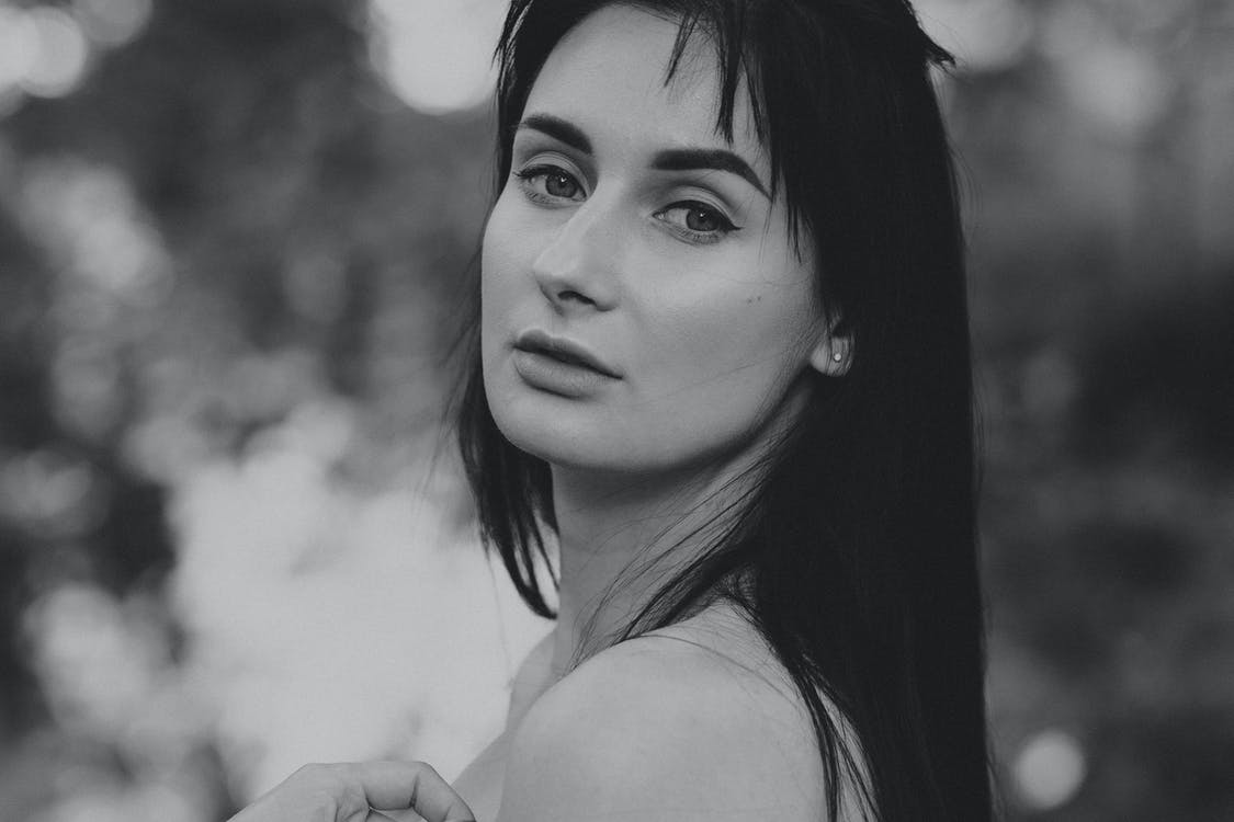 Selective Focus Grayscale Photo of Woman Posing