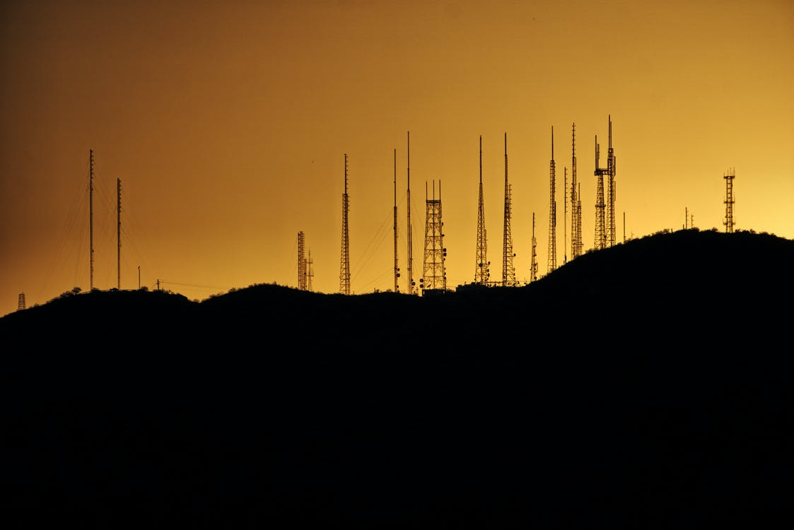 Silhouette Photo of Transmission Tower on Hill