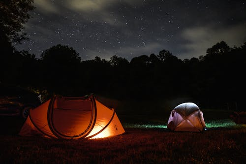 Two Lighted Dome Tent During Nighttime