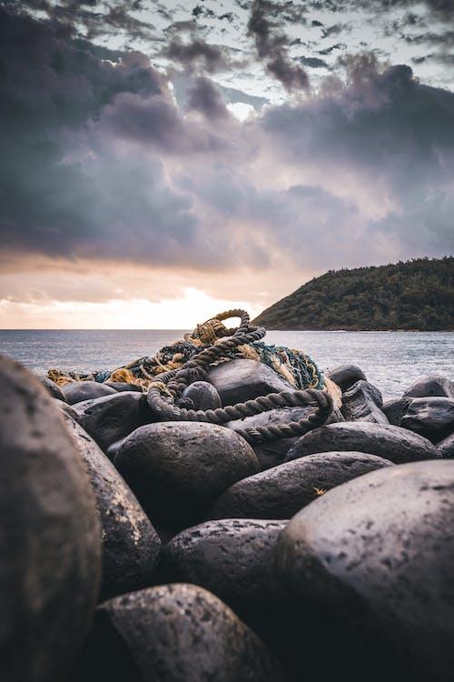 Rope On Rocks Near Ocean