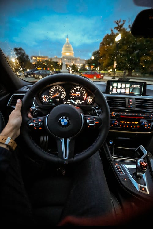 Person Holding Bmw Steering Wheel