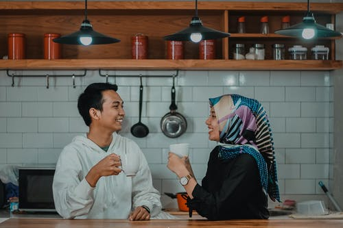 Man and Woman Drinking Tea in Kitchen
