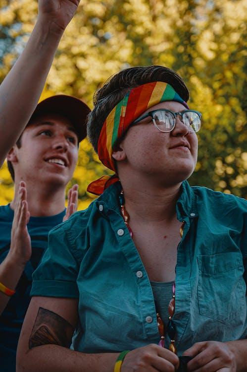 Photo of Person Wearing Multicolored Bandana