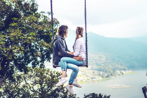 Couple Sitting on Swing