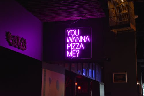 Photo of a Purple Neon Signage