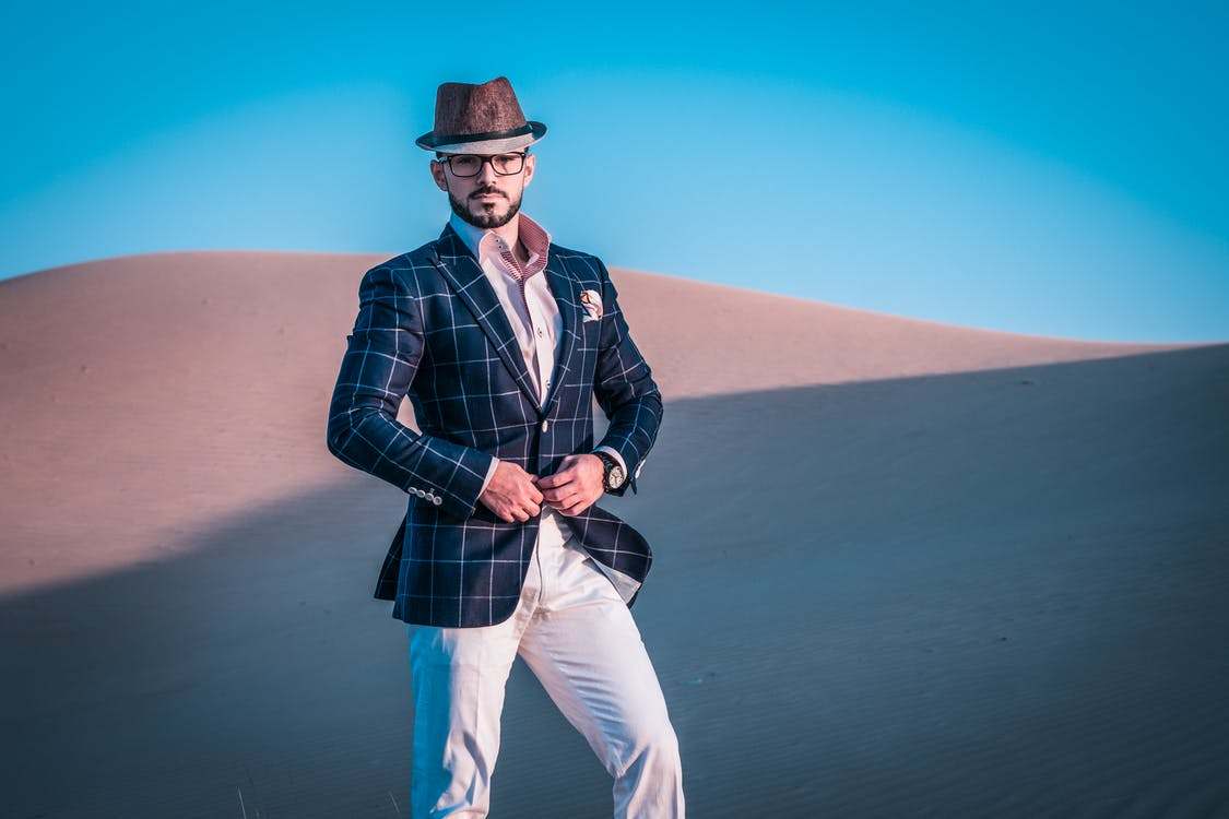 Photo of a Man Standing in Desert