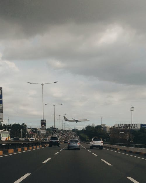Free stock photo of airplane, busy street, highway