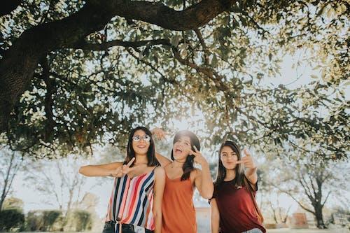 Women Standing Under Tree