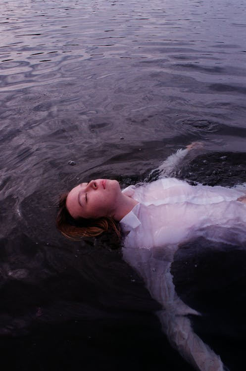 Woman On Body Of Water