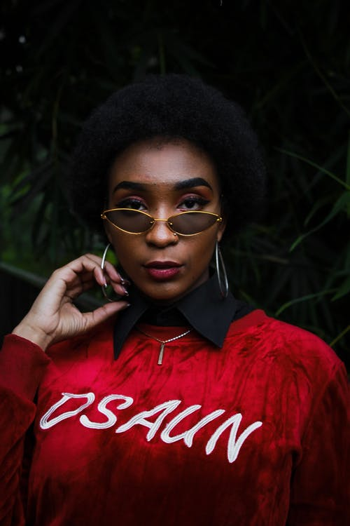 Photo of Woman Wearing Red Sweater and Sunglasses