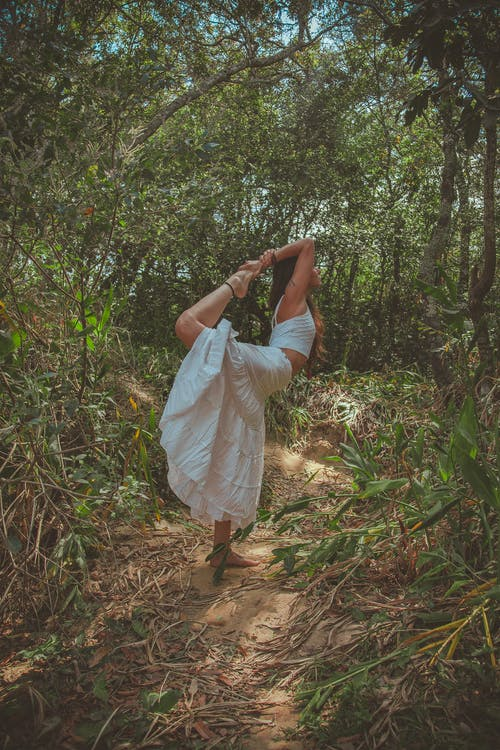 Photo of Woman Doing Yoga in Forest